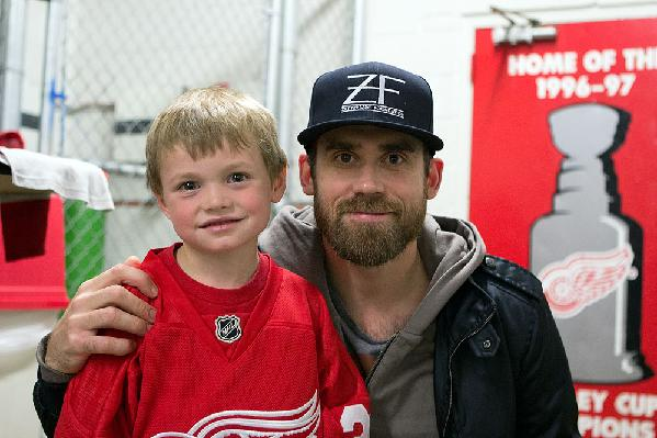 Owen hangs out with Red Wings captain Henrik Zetterberg after practice.
